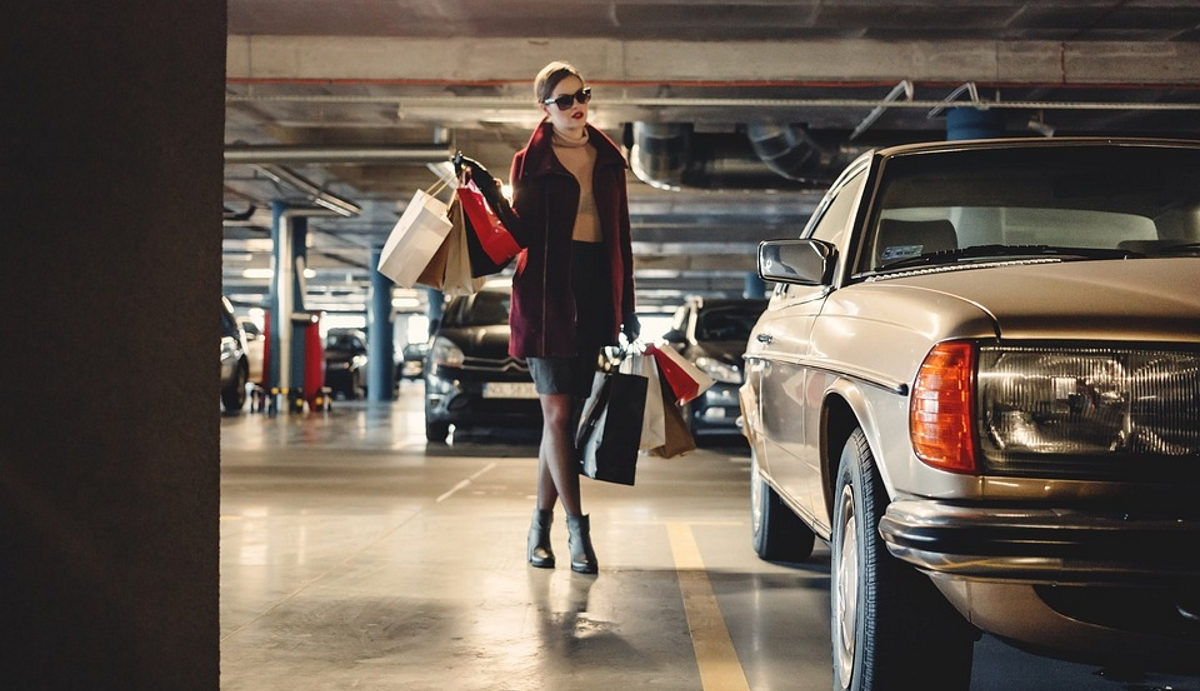 Woman shopping car park